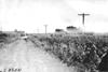Glidden tourist vehicle stopped on muddy road near Woodbine, Iowa at 1909 Glidden Tour