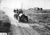 Gus Buse in Thomas car on rural road near Missouri Valley, Iowa at 1909 Glidden Tour