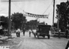 Glidden tourist car passes under welcome banner at Council Bluffs, Iowa at 1909 Glidden Tour