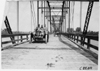John C. Moore driving the Lexington car #114 over Loup River bridge, at the 1909 Glidden Tour