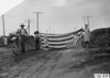 Kelley twins and their flag at Chapman, Neb., at the 1909 Glidden Tour