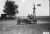 Chalmers car in front of windmill near Kearney, Neb., at 1909 Glidden Tour