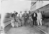 Group of tourists posed on railroad tracks in Kearney, Neb., at 1909 Glidden Tour