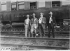 George Smithson and three newspaper men posed in front of Pullman car in Kearney, Neb., at 1909 Glidden Tour