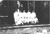 Pullman employees pose in front of railroad car in Kearney, Neb., at 1909 Glidden Tour