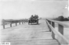 Frank E. Wing in Marmon car crossing the bridge of the North Platte River in Neb., at the 1909 Glidden Tour