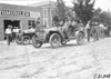 Duesenberg in Mason stopped in front of an automobile store at Ft. Morgan, Colo., at 1909 Glidden Tour