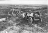 Group photo of Glidden tourists posed in front of vehicle on the Colorado prairie, at 1909 Glidden Tour