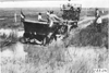 Glidden tourist vehicle pulled from the mud by a team of horses, on Colorado prairie, at 1909 Glidden Tour