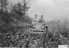 Glidden tourist vehicle on muddy road in Colorado, at 1909 Glidden Tour