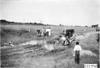 Glidden tourist vehicle stuck in mud on Colorado prairie, at 1909 Glidden Tour