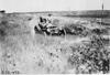 Maxwell car passing through ditch near Aurora, Colo., at 1909 Glidden Tour