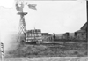 Windmill with farm family in Nebraska, at the 1909 Glidden Tour