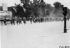 Glidden tourists, led by marching band heading toward Lakeside Park, Denver, Colo., at 1909 Glidden Tour