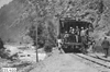 Glidden tourists standing on the back of a train in Clear Creek Canyon, Colo., at 1909 Glidden Tour