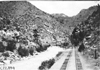 Creek near railroad tracks in Clear Creek Canyon, Colo., at 1909 Glidden Tour