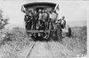 Glidden tourists standing on the back of a train headed for Mt. McClellan, Colo., at 1909 Glidden Tour