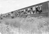 Glidden tourists look out from railroad cars headed for Mt. McClellan, Colo., at 1909 Glidden Tour