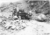 Rapid motor truck stuck on rock covered mountain road in Colo., at 1909 Glidden Tour