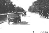 Glidden tourists driving down tree lined street near Colorado Springs, Colo., at 1909 Glidden Tour