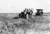 Glidden tourists passing through field, at the 1909 Glidden Tour