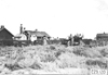 Glidden car stopped at farm, at the 1909 Glidden Tour