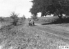 Jean Bemb in Chalmers car on rural road in Kansas, at 1909 Glidden Tour