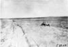 Glidden tourists on rural road in desolate area of Kansas, at 1909 Glidden Tour
