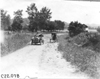 Glidden tourist car #83 passing horse-drawn vehicle on rural road near Junction City, Kan., at 1909 Glidden Tour