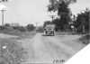 Thomas press car and Rapid motor truck on rural road near Junction City, Kan., at 1909 Glidden Tour
