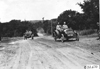 Glidden tourist car #107 and Moline car on rural road near Junction City, Kan., at 1909 Glidden Tour