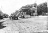 Maxwell car next to street car in Junction City, Kan., at 1909 Glidden Tour