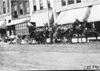 Horse-drawn vehicle parked in front of market in Junction City, Kan., at 1909 Glidden Tour