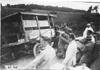 Glidden tourists help right a Firestone truck on rural road near Manhattan, Kan., at 1909 Glidden Tour