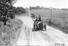 George Weidely in Premier car on rural road near Manhattan, Kan., at 1909 Glidden Tour