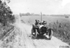 Van Dervoort in Moline car on rural road near Manhattan, Kan., at 1909 Glidden Tour