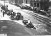 Line up of cars on city street in Kansas City, Mo., at 1909 Glidden Tour