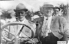 Walter Winchester and unidentified man posed in Pierce car, at 1909 Glidden Tour