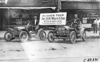 Two Brush runabout cars with drivers posed in front of building in Kansas City, Mo., at 1909 Glidden Tour