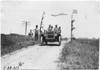 Smithson in Studebaker car on rural road, at 1909 Glidden Tour