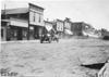 Glidden participants in rural town, at the 1909 Glidden Tour