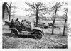 E.M.F. car passing farm, on pathfinder tour for 1909 Glidden Tour