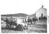 E.M.F. car parked near school, students look on, on pathfinder tour for 1909 Glidden Tour