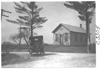 E.M.F. car passing a school, on pathfinder tour for 1909 Glidden Tour