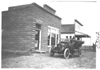 E.M.F. car parked in front of a bank, on pathfinder tour for 1909 Glidden Tour