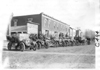E.M.F. car along side other cars parked in front of commercial buildings, on pathfinder tour for 1909 Glidden Tour
