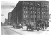 E.M.F. car on city street in business district, on pathfinder tour for 1909 Glidden Tour