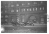 E.M.F. car next to large, stone building, on pathfinder tour for 1909 Glidden Tour