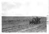 E.M.F. car on prairie with sheep, on pathfinder tour for 1909 Glidden Tour