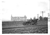E.M.F. car passing First Capitol of Kansas building, on pathfinder tour for 1909 Glidden Tour